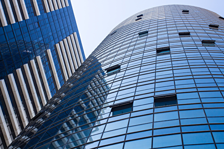 architectural firm: View of commercial office buildings on sky background