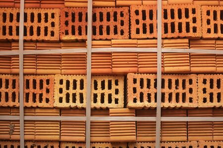 Closeup of perforated orange bricks stacked in a blocks Stock Photo
