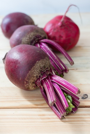 Red beet or beetroot on the wooden table. Banco de Imagens