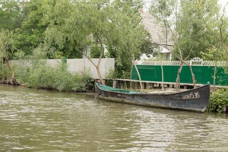 Danube river and fishing boat near the shore on a summer day. Vilkovo, Ukraine Archivio Fotografico