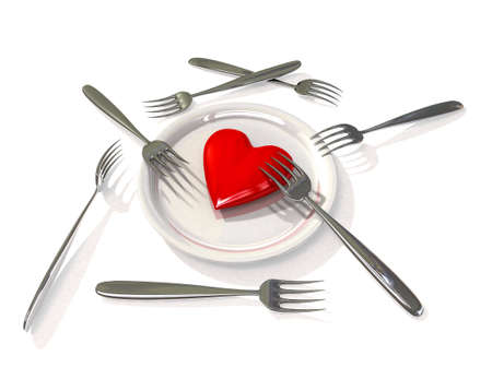 Heart on plate with forks Stock Photo