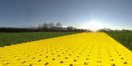 gravel roads: Gold brick road on grass with sun and blue sky