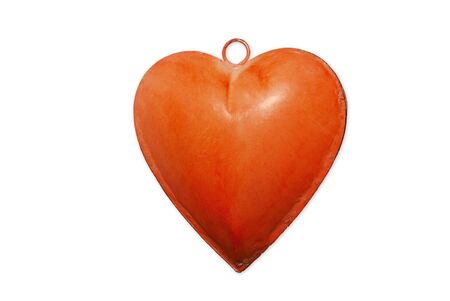 Christmas ornament representing a metallic orange heart with a ring Stock Photo