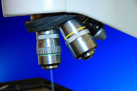 Close up of laboratory microscope objective with a blue ray Stock Photo