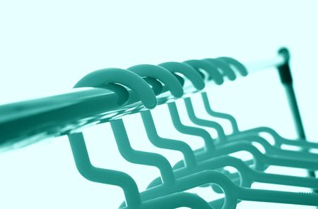 Close shot of clothes-hangers. Duotone like picture Stock Photo