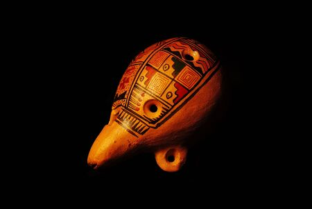 Traditional clay painted ocarina on black background Stock Photo - 586232