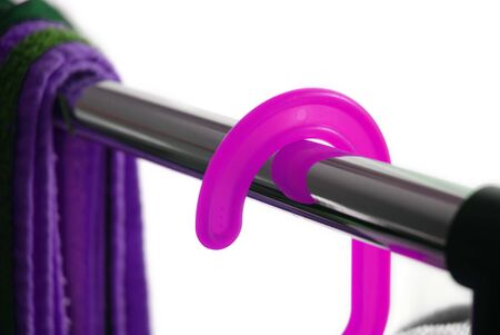 Close shot of a pink hanger on a metallic rack Stock Photo - 778157
