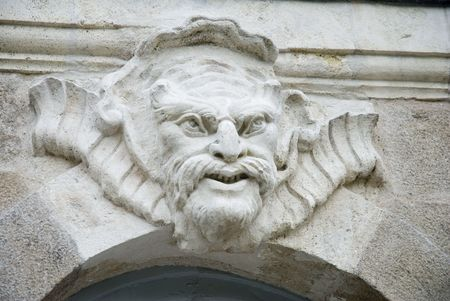 Architectural sculpture - mascaron - on the facade of a 18th century building in Nantes, France.