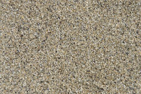 Close shot of sea sand. Suitable for background texture.