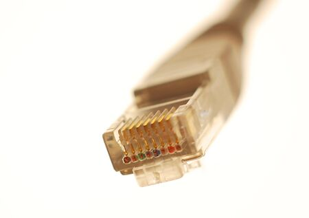 Close shot or a RJ-45 network connector on white background.