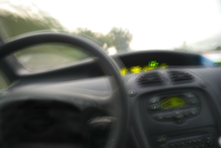 vision concept: Blurry vision from a car driver point of view. Concept of danger when driving with alcohol, drugs or fatigue