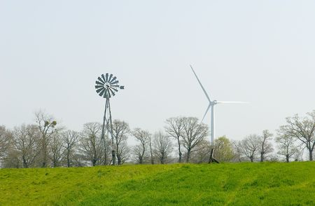 free image: Wind turbine and old windmill water pump.