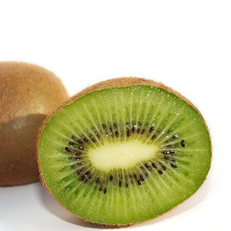 Close shot of a kiwifruit cut in half