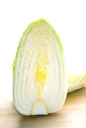 Chinese cabbage on wooden plate and white background