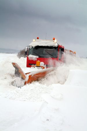 the plough: snowplow or plough clear snow of road during winter blizzard or storm