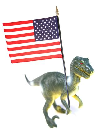imperialism: american imperialism symbol. t-rex holding stars and stipes flag of usa isolated on white Stock Photo