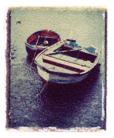 two rowing boats on lake or sea. image transfer with grunge look Stock Photo