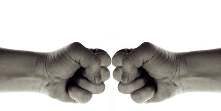 fist isolated on white, hand sign of war, power and conflict but also symbol for martial arts