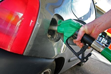 petrol nozzle fill car with fuel. gas station and vehicle