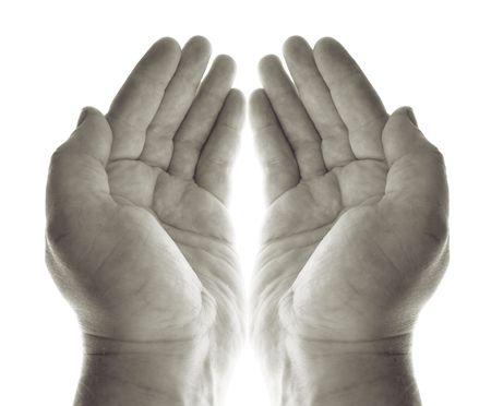 mani pregare o mendicare per carit� o benedizione. palme a mano in bianco e nero che ricevono