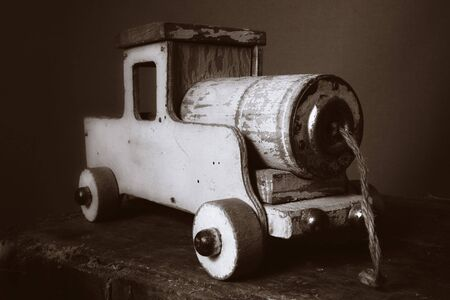 train toy vintage or old wooden locomotive. childs toy or decorative object photo
