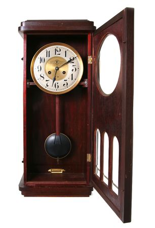 wood tick: clock, old vintage time piece in wood and brass showing just past twelve or midnight isolated on white