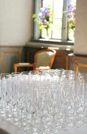 champagne glasses set up for wedding reception or celebration. table arrangement with glass photo
