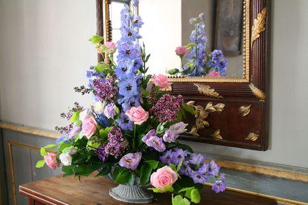 flower arrangement by mirror. decorative bouquet of bloom Stock Photo - 5788305