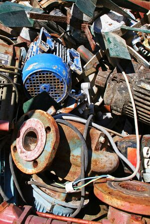 discarded metal: rubbish dump pollution with industry scrap polluting the environment