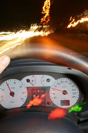 driving car at night with motion blur and lights. view of dashboard photo