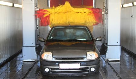 car wash machine automatic cleaning of vehicle with brushes soap and water Stock Photo - 5778081