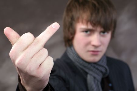 get lost or f... off sign. youth with bad attitude signal aggression with the finger Stock Photo - 5778029