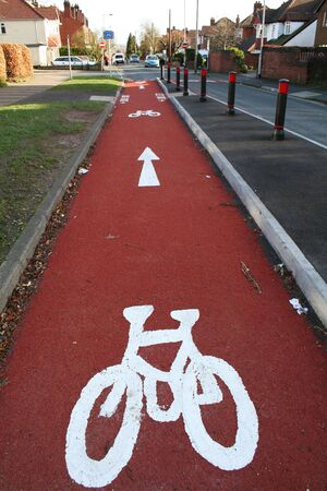 Cycling lane marked with bicycle sign painted on pathway Stock Photo - 5795211