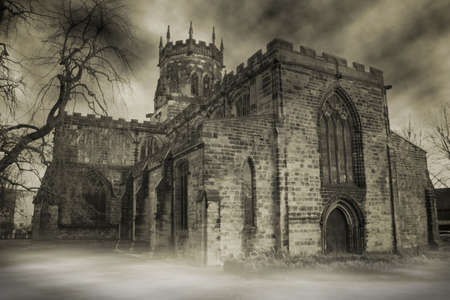 spooky english church in fog or haze. medieval christian building Stock Photo