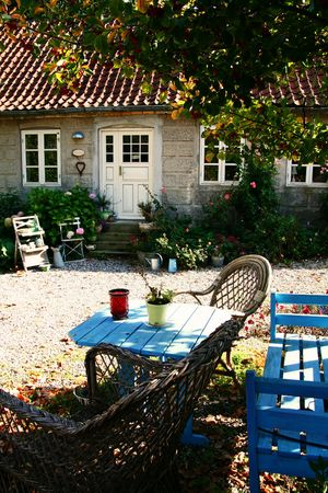 courtyard of farm with rustic furniture and table on sunny day Stock Photo - 5795383
