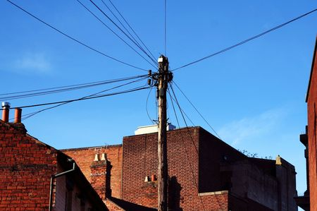 telegraphs: telephone communication lines connection. urban wire network between houses  Stock Photo