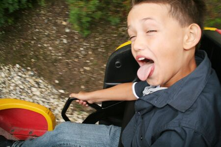 roller coaster ride. child screaming with joy in amusement park ride photo