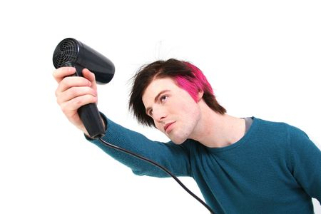 Groom hair. male teenager blow dry hair try to style it photo