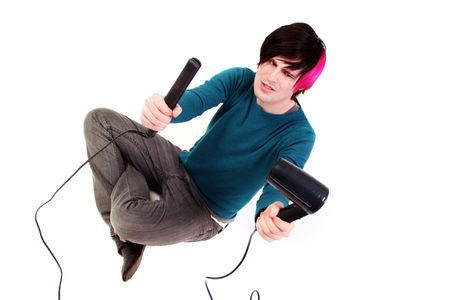 blow drier: Groom hair. male teenager blow dry hair try to style it