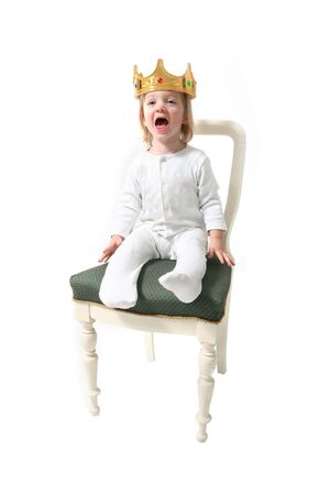 Child is king. toddler with crown isolated on white symbol for ruler