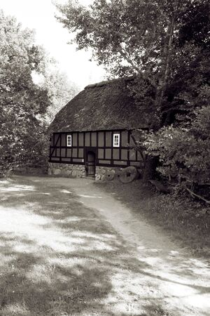 Traditional danish farm house or rural agriculture building. architecture from denmark in the countryside photo