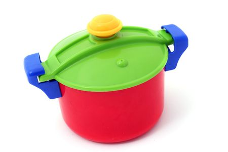 saucepan with lid isolated on white. Childs plastic pot cooking toy  photo