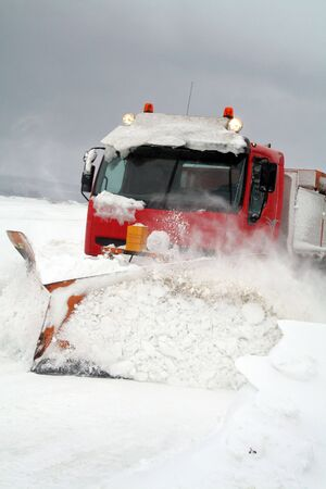 snow drift: snowplow or plough clear snow of road during winter blizzard or storm