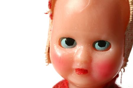 dolls head. childs vintage toy. baby doll isolated on white photo