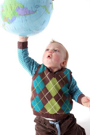 child playing with globe or earth. toddler with planet isolated on white photo