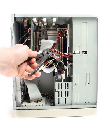 repair computer pc. open and service or damage by disconnecting parts with pliers Stock Photo - 5778058