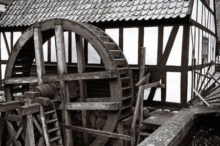 watermill. Old historic water mill producing energy for grinding corn to flour Stock Photo