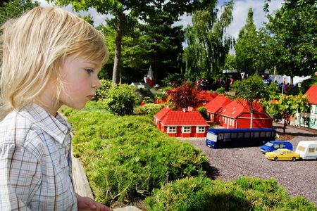 child in looking at lego models. summer vacation in theme amusement park Stock Photo