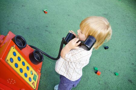 Child with play phone. boy speaking in telephone and listening Stock Photo - 5795111