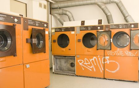 launderette with washing machines or tuble dryers. coin washing laundromat photo